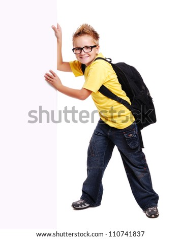 Schoolboy pushing big blank board - stock photo