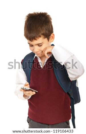 Schoolboy reading sms message on the phone mobile isolated onw hite background - stock photo