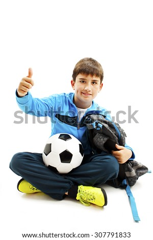 Schoolboy showing OK sign. Isolated on white background - stock photo
