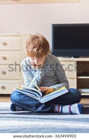 Schoolboy studying hard - stock photo