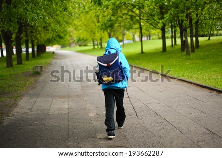 schoolboy walk alone - stock photo