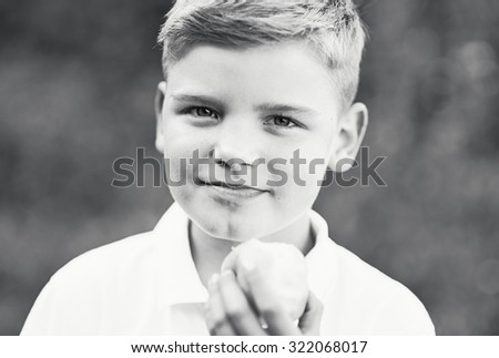 Schoolboy with applle - stock photo