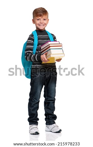Schoolboy with backpack and books, isolated on white background - stock photo