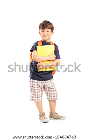 Schoolboy with backpack holding a notebook isolated on white background - stock photo