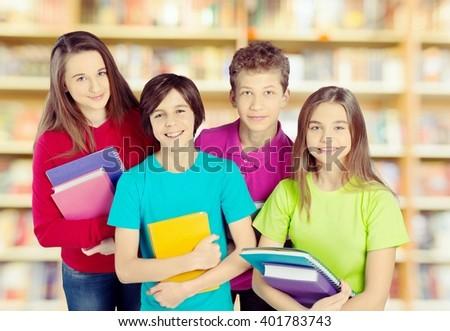 Schoolchild in library. - stock photo