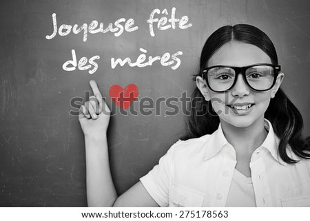Schoolchild with blackboard against french mothers day message - stock photo