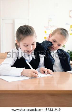 schoolchildren on the lesson in a classroom - stock photo