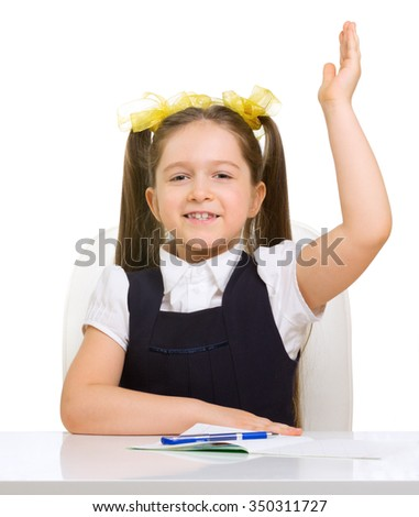Schoolgirl at her desk isolated - stock photo