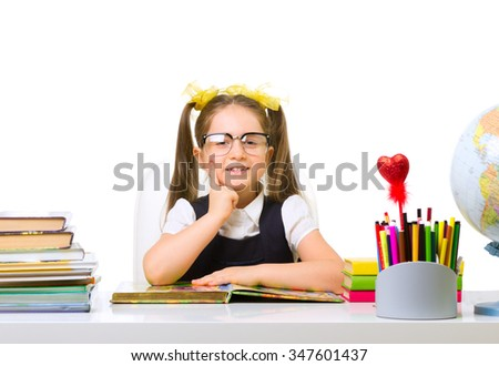 Schoolgirl at the table isolated - stock photo