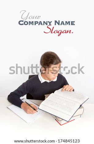 Schoolgirl consulting a dictionary while writing an essay  - stock photo