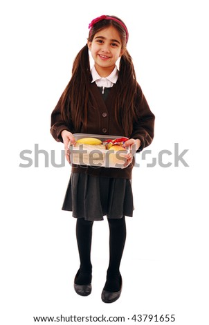 Schoolgirl holding healthy packed lunch isolated on white - stock photo