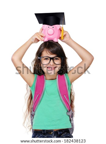 schoolgirl holding piggy bank with mortar board:savings for future education  - stock photo