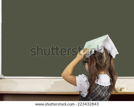 Schoolgirl in school boards - stock photo