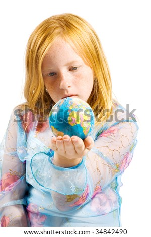 schoolgirl is looking at the world laying in her hand on white - stock photo