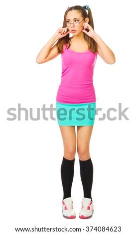 Schoolgirl plug ears isolated on white - stock photo