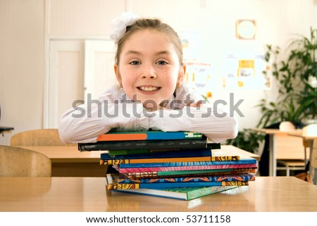 schoolgirl reading in a classroom - stock photo