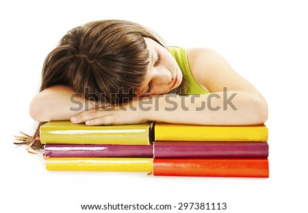 Schoolgirl sleeping on school books. Isolated on white background - stock photo