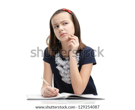 Schoolgirl thinks over the task, isolated, white background - stock photo