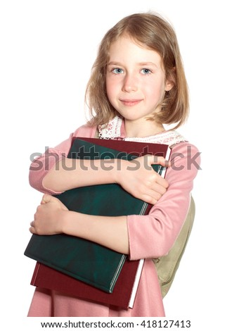 Schoolgirl with books in her hands. Isolated on white. - stock photo