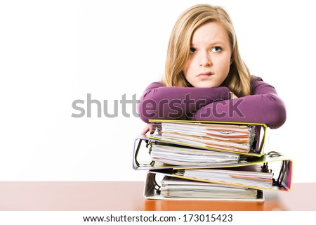 Schoolgirl with books isolated on white - stock photo