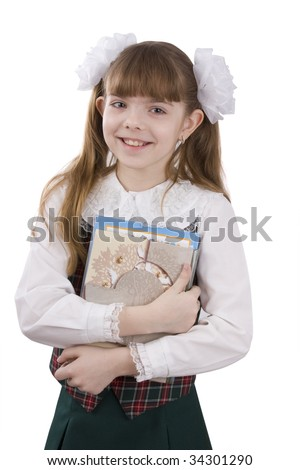 Schoolgirl with textbook. Portrait of smiling, little girl in school uniform. Little pupil is going to school. Isolated over white background. - stock photo