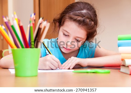 Schoolgirl writing - stock photo