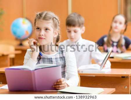 schoolkids work at lesson - stock photo