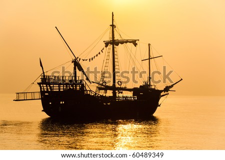 Schooner silhouette at sunset - stock photo