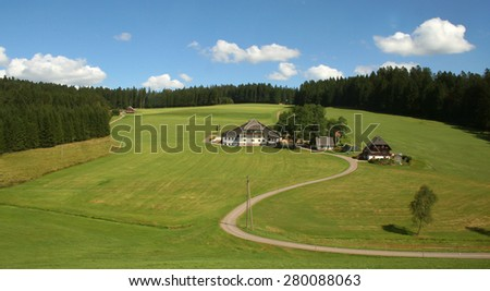 Schwarzwald / Black Forest / Black Forest. Beautiful landscape with a small house and the road. - stock photo