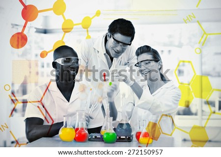 Science and medical graphic against group of smiling scientists examining testtubes - stock photo