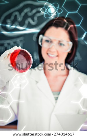 Science and medical graphic against portrait of a redhaired scientist looking at a petri dish - stock photo