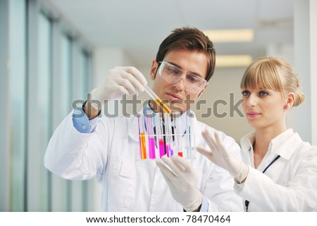 science and research biology chemistry an dmedicine  youn people couple in bright modern  lab - stock photo