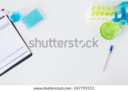science, chemistry, biology, medicine and advertisement concept - close up of scientific laboratory table with stuff - stock photo