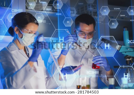 science, chemistry, biology, medicine and people concept - close up of young scientists with pipette and flasks making test or research in clinical laboratory over hydrogen chemical formula - stock photo