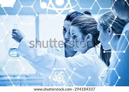 Science graphic against cute chemistry students holding a flask - stock photo