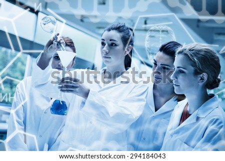 Science graphic against cute science students pouring liquid in a flask - stock photo