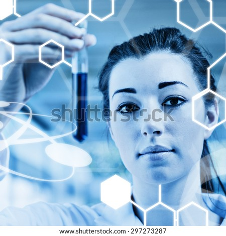 Science graphic against cute student holding a test tube - stock photo