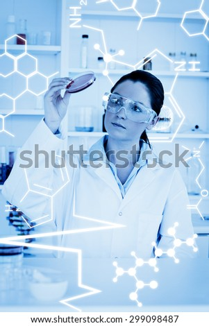 Science graphic against young scientist - stock photo