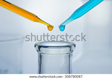 science laboratory pipette with drop  - stock photo