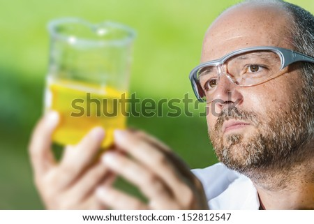 Scientific chemistry laboratory investigated in a liquid measuring cup - stock photo