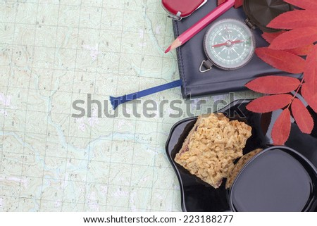 scientific expedition  on the map. compass. cup, cookies - stock photo