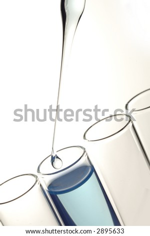 scientific lab glassware in special lighting - stock photo