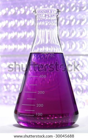 Scientific laboratory glass conical Erlenmeyer flask filled with purple chemical liquid for a chemistry experiment in a science research lab - stock photo
