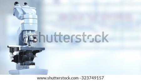 Scientific microscope in laboratory. Health care background. - stock photo