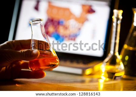 scientist doing research and holding a glass container - stock photo