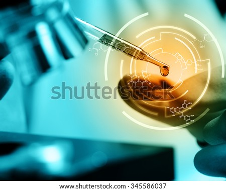 Scientist  dropping chemical liquid to microscope with chemical equations , Laboratory research concept - stock photo