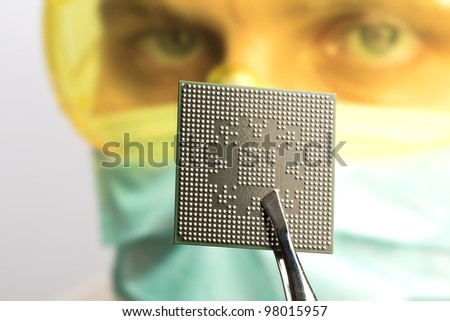Scientist examining a microchip - stock photo