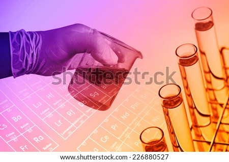 Scientist hand holding beaker ,Laboratory research concept - stock photo