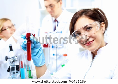 Scientist in uniform doing tests in laboratory - stock photo