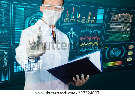 scientist pointing futuristic screen - stock photo